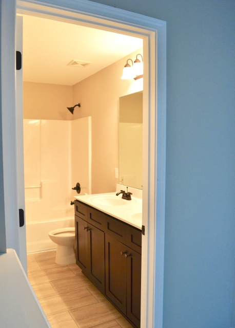 Upstairs bathroom with double vanities